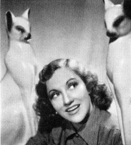 Connie Boswell with ceramic cats, late 1930s.