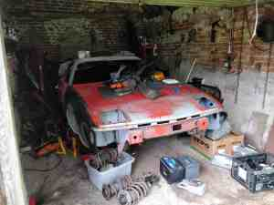 TR7 in messy garage