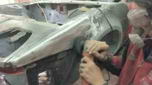 TR7 wing being stripped of paint