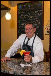 """Bartender Mark Barrett at Chez Andree, serving up the ever popular """"Cosmo."""" Photo Credit © Chester Simpson"""