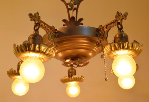 Vine chandelier, lit, close up