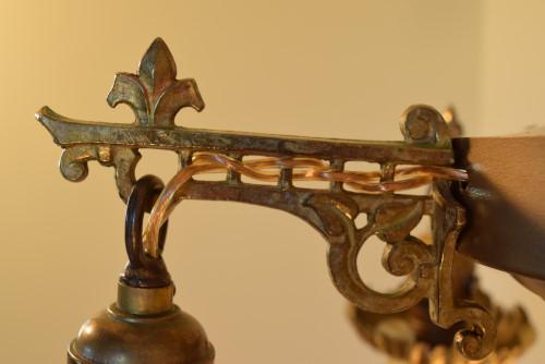 Vine chandelier, support arm close up