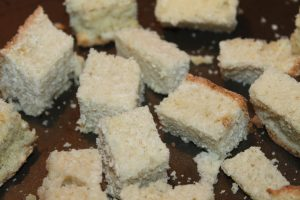 Tear or cut bread into evenly sized cubes for even baking time.
