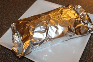 Wrapping the bread in foil shortly after it is taken out of the oven is the secret to keeping it moist