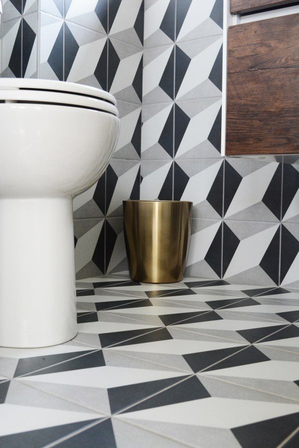 Bold geometric patterned tile on the bathroom floors and walls.