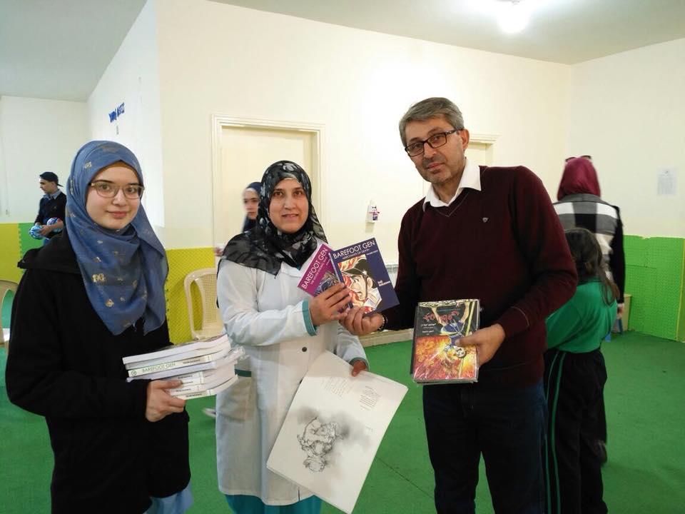 Khalil with teachers