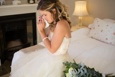 Crying lady on wedding gown