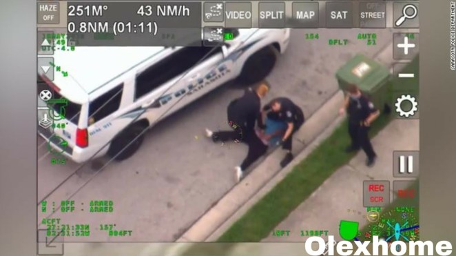 White police kneeling on black suspect's neck in Florida