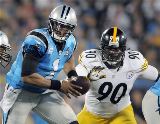 Carolina Panthers' Cam Newton looks to hand of the ball as Pittsburgh Steelers' Steve McLendon draws near, Sept. 2016.