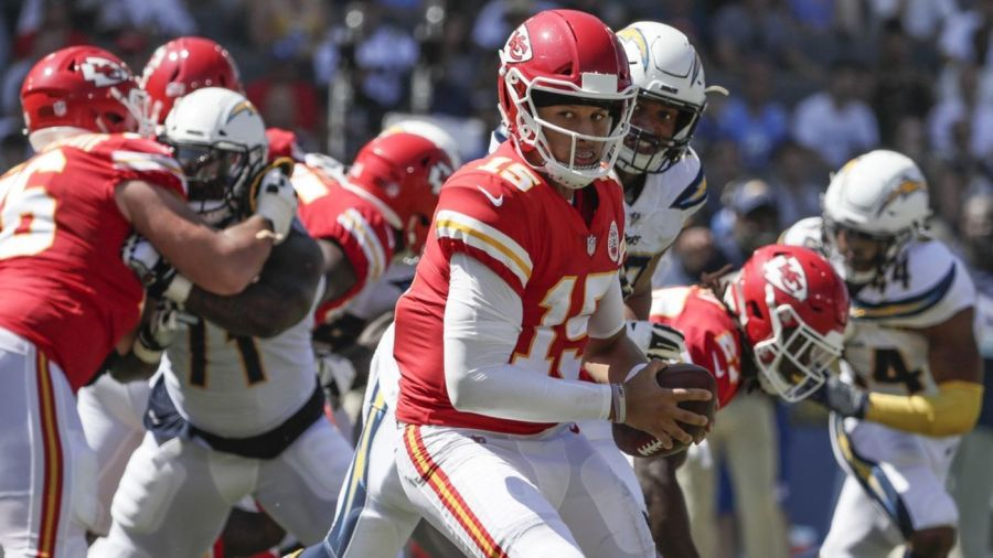 Patrick+Mahomes+%2815%29+avoids+a+pass+rush+from+the+Chargers+defense%3A+Week+9%2C+2018.