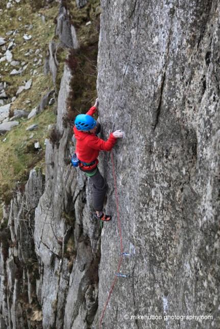 Climbing the technical but better protected upper arete of Rare Lichen E8/9 6c, Gribbin Facet © Mike Hutton