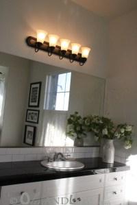 Spray Painting Bathroom Light Fixture | oliveandlove