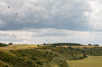 Paragliders flying over the top of the downs, with a couple of gliders above them. Photos from a walk around National Trust Dunstable Downs and the Whipsnade Estate SSSI's, in the Bedfordshire area of Chilterns AONB.