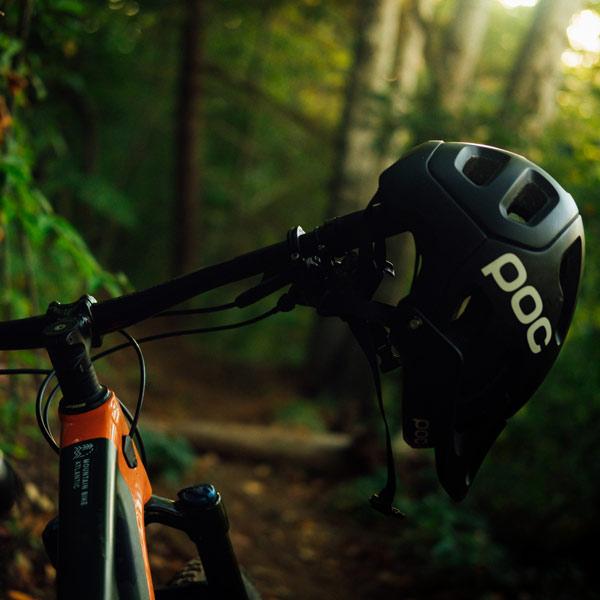 Photo of a bike with helmet on the handlebar.