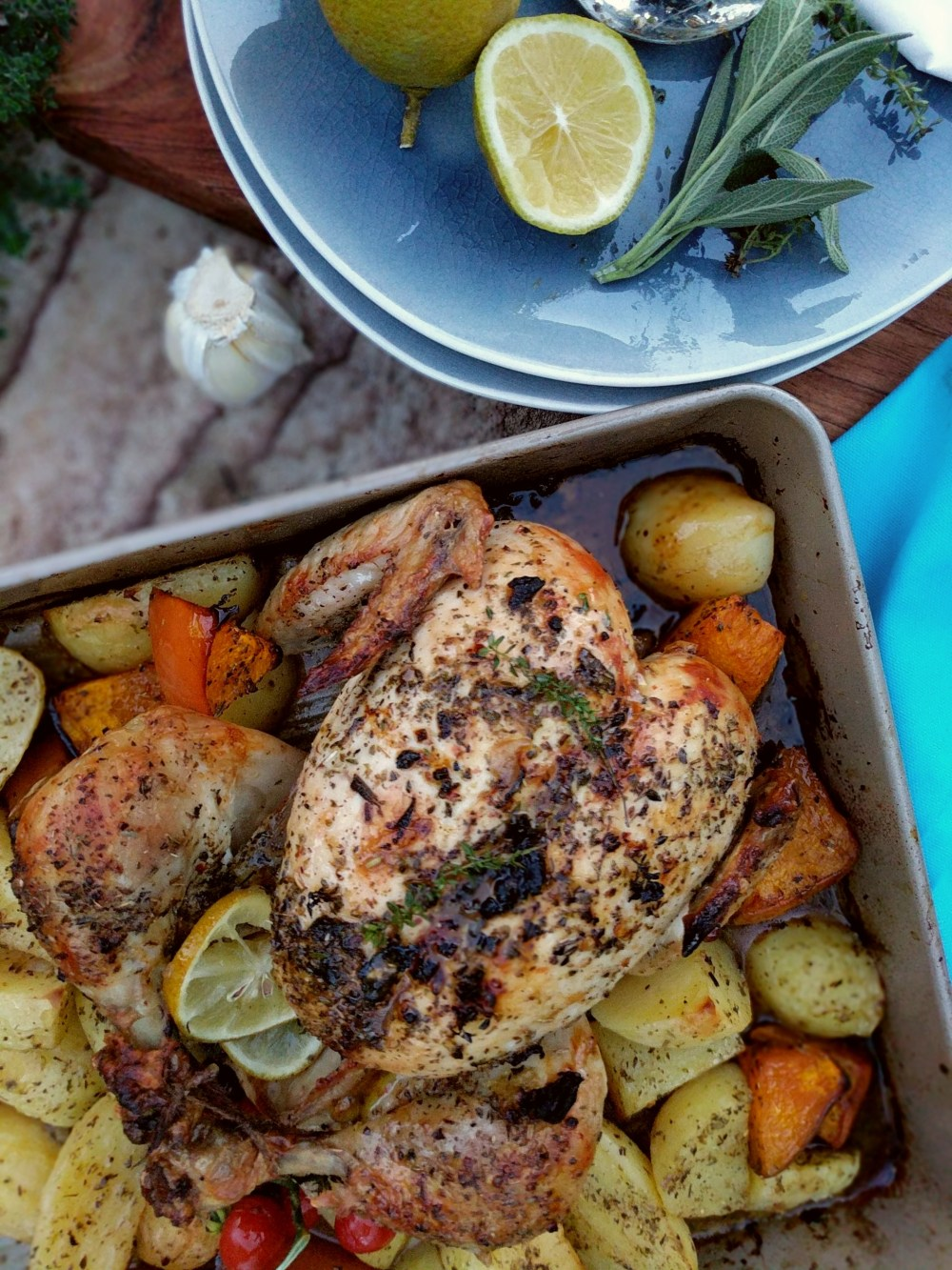 easy greek style roasted chicken with  potatoes and flavoured with lemons, garlic and spices.