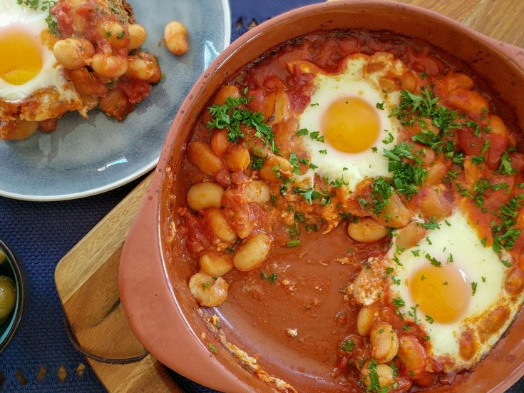 Baked Eggs Shakshuka with tomato sauce and beans