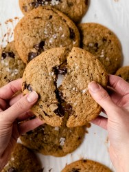 hands pulling apart a melty chocolate chip cookie
