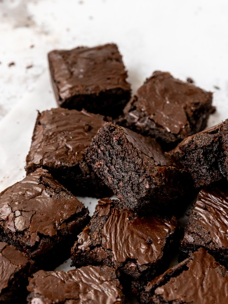 close up shot of triple chocolate lavender brownies
