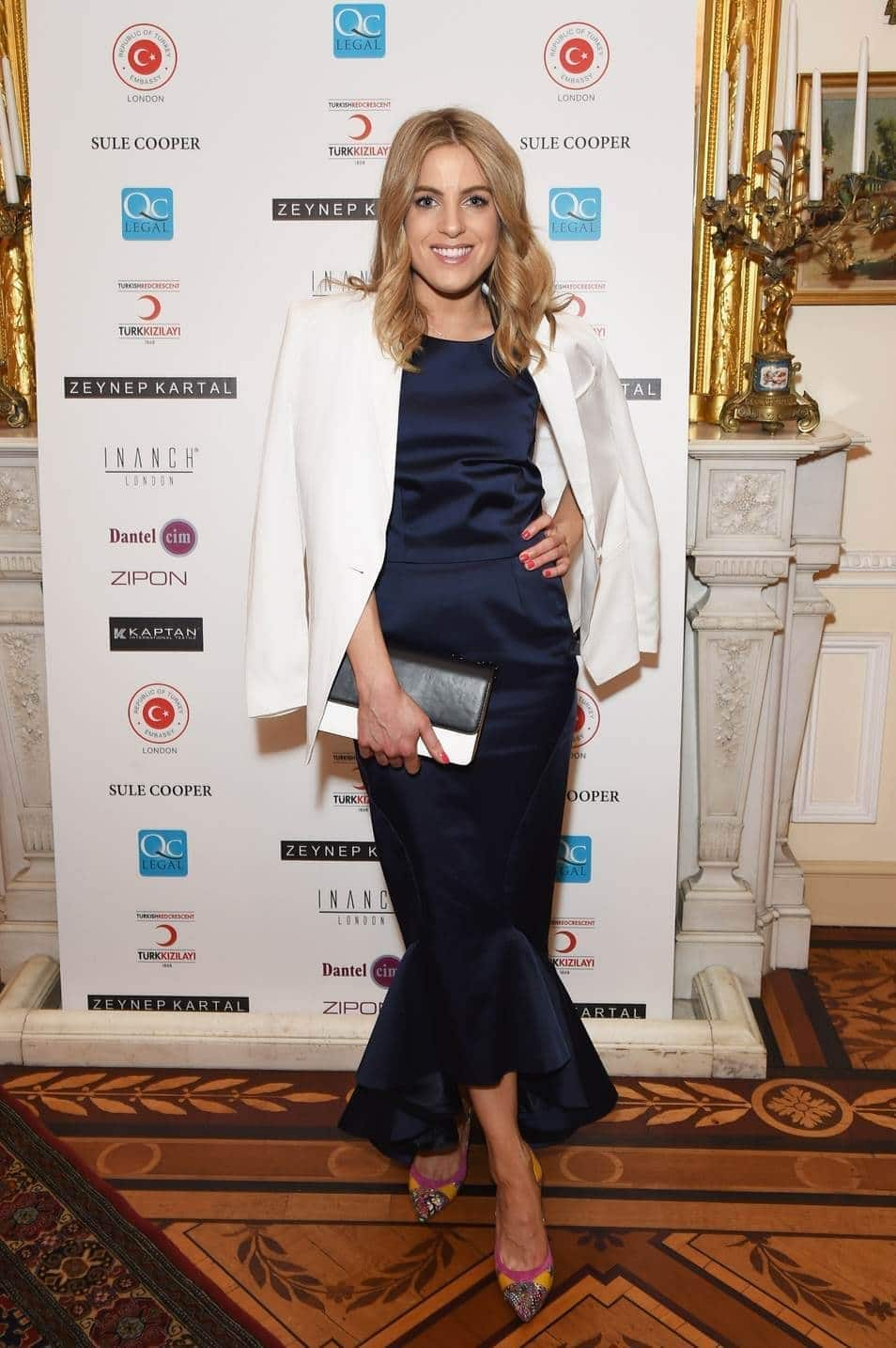 Olivia attends Zeynep Kartal's charity fashion show at the Turkish Ambassador's residence