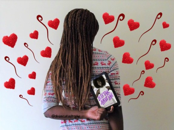girl holding lets talk about love by claire kann ebook surrounded by love hearts olivia's catastrophe