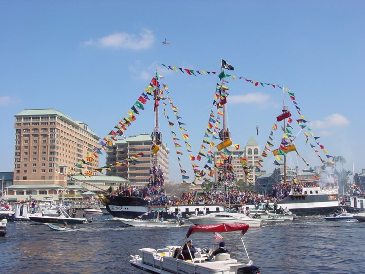 The Jose Gasparilla pirate ship escorted by a flotilla of hundreds of local vessels