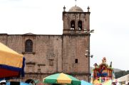 iglesia de san francisco and the carnival being held outside