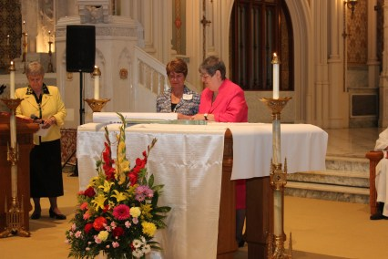 CDP Superior General Sister Peal Caesar and OLLU President Dr. Diane Melby sign the transfer document