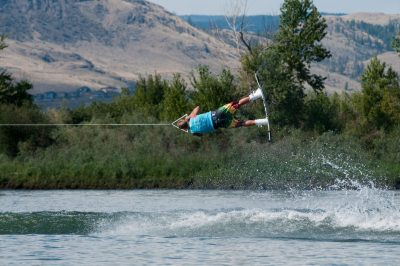 Wakeboarders rock the river at Kamloops, BC during a summer Wakeboarding event in the Tournament Capital