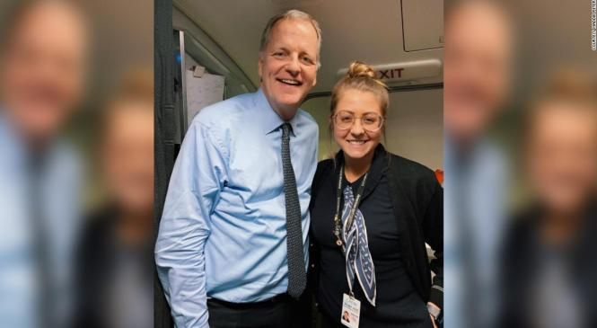 American Airlines flight attendant accidentally drops a drink on a passenger. It was the CEO