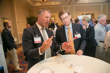 Dr. Howie Levinson shows off his hernia mesh design to President Price. Deep Blue is addressing the unacceptably high rate of hernia occurrence and recurrence. Photo by Jared Lazarus/Duke Photography