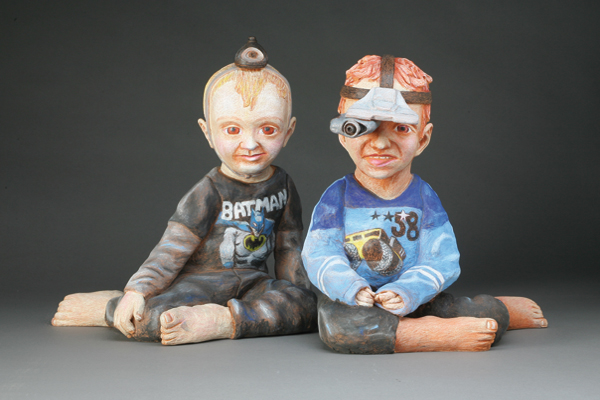 """Tech Twins,"" stoneware and mixed media by Joe Batt"