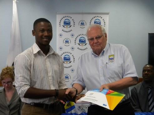 Youth Ambassador Ryan Brathwaite receiving his Nanjing Road Book from President of the BOA, Steve Stoute.