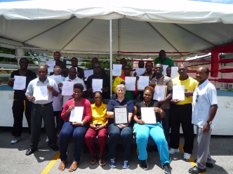 Boxing coaches with their certificates in Barbados