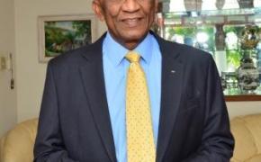 Sir Austin Sealy, SCM – IOC Member