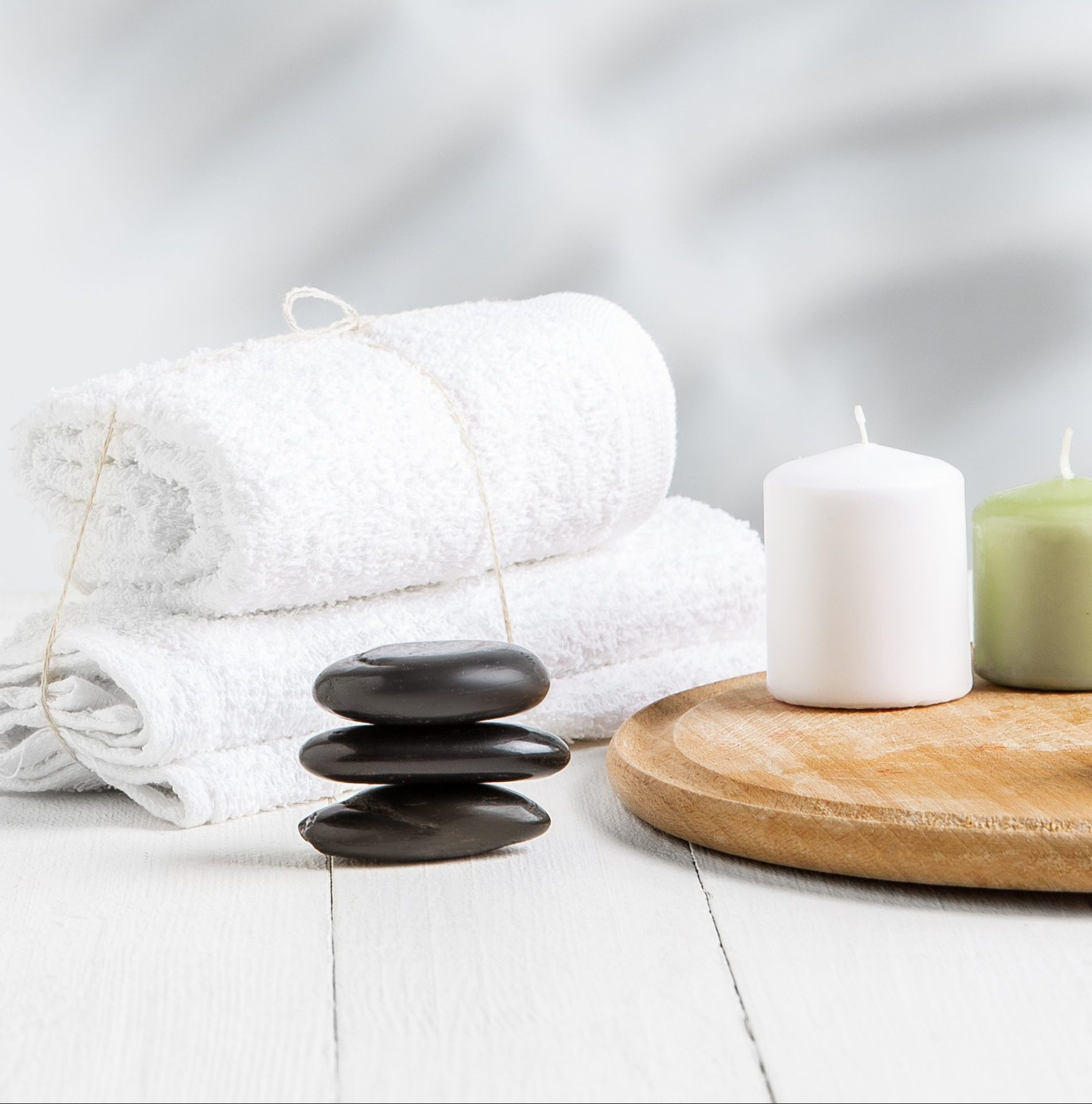 Beautiful spa composition on massage table in wellness center, copyspace