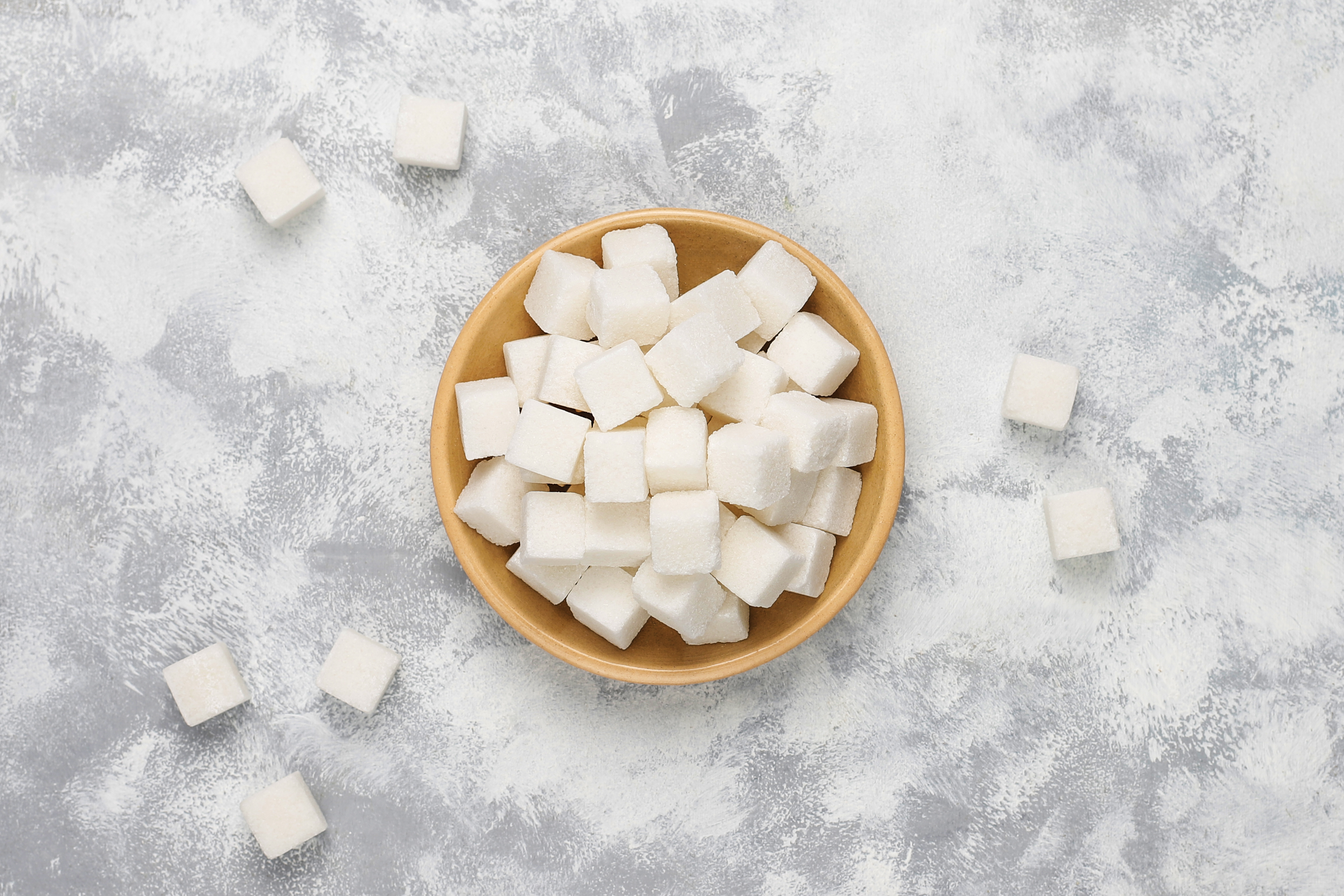 White sugar cubes on concrete background,top view