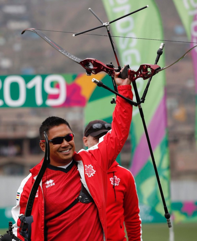 Archery athlete waves to the crowd