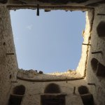 View up through the courtyard in an old village in Manah