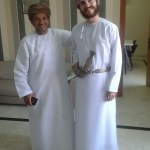 Me wearing the Omani Khanjar - a ceremonial dagger - with Yusuf, a teacher in the insitute