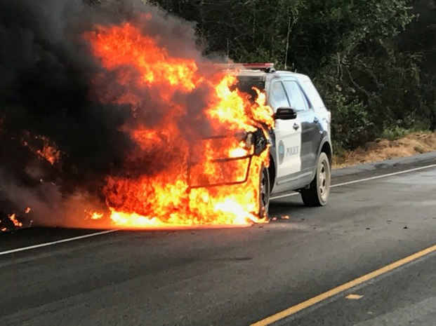 A police vehicle parked on Highway 154 is engulfed by flames of the Whittier wildfire near Santa Ynez, California, U.S. July 9, 2017. Santa Barbara County Sheriff's Office/Handout via REUTERS. ATTENTION EDITORS - THIS IMAGES WAS PROVIDED BY A THIRD PARTY. TPX IMAGES OF THE DAY