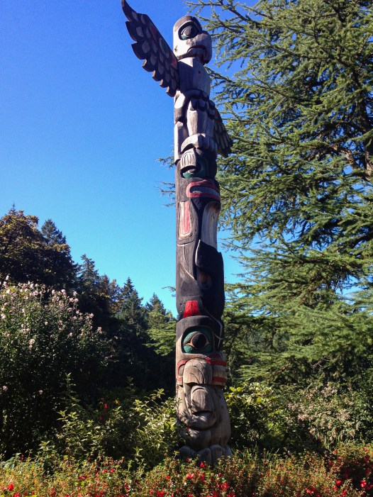 Coast Salish style totem poles installed in 2004 to commemorate the 100th anniversary of The Butchart Gardens and to honor the cultural heritage of the indigenous people in the area