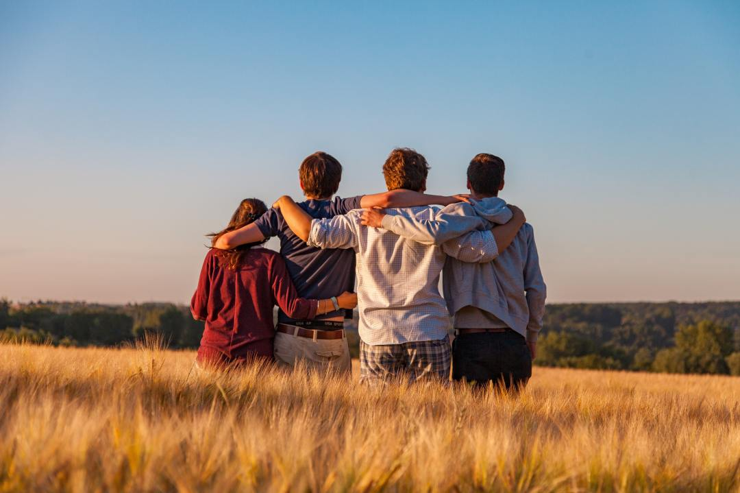 A group hug in a field