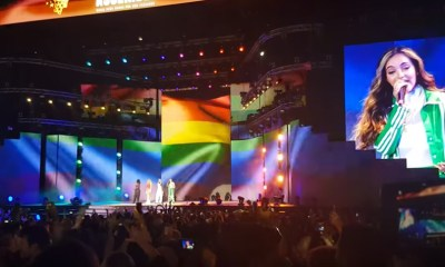 Little Mix sings under massive rainbow flag during performance in Dubai