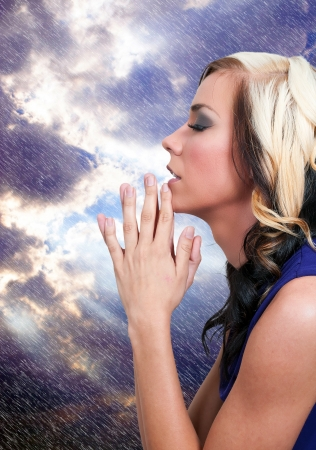 14880495 - beautiful christian woman in a deep prayer