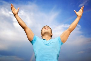 10855329 - happy young man with raised arms and closed eyes against blue sky