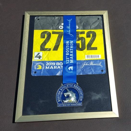 2019 Boston Marathon medal in frame