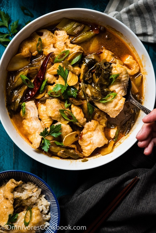 Suan Cai Yu (酸菜鱼, Sichuan Fish with Pickled Mustard Greens) - The fish is sliced thinly and poached in a rich broth made from chicken stock, fish stock, and Sichuan pickles.   omnivorescookbook.com