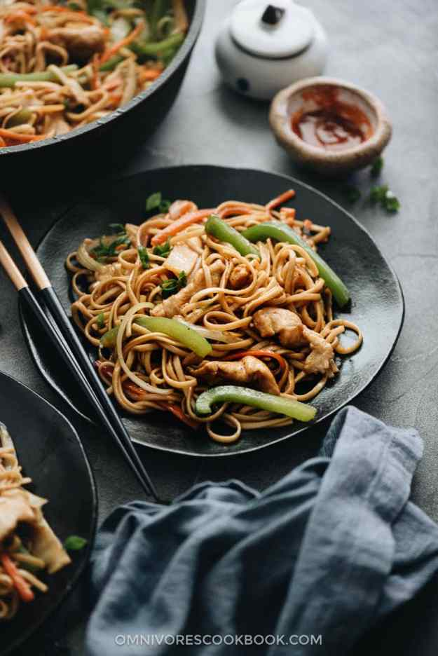 Chicken Lo Mein with peppers, onion, and bamboo shoots served on a plate