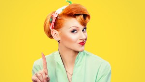 woman gesturing a no sign. Closeup portrait unhappy, serious pinup retro style girl raising finger up saying oh no you did not do that yellow background. Negative emotions facial expressions, feelings