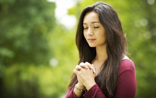Woman praying outside